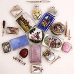A selection of silver and enamel items